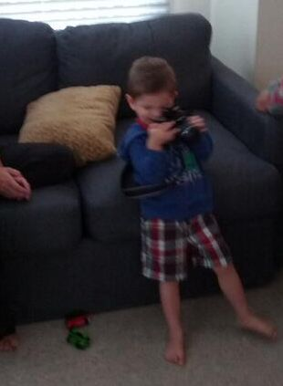 My Boy Holding The Wife's Camera